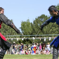 Josh Avery, left, duels Edwin Brazzero during an exhibition by the Knights of Mayhem during the Utah Renaissance Faire at Thanksgiving Point's Electric Park in Lehi on Friday, Aug. 23, 2019.
