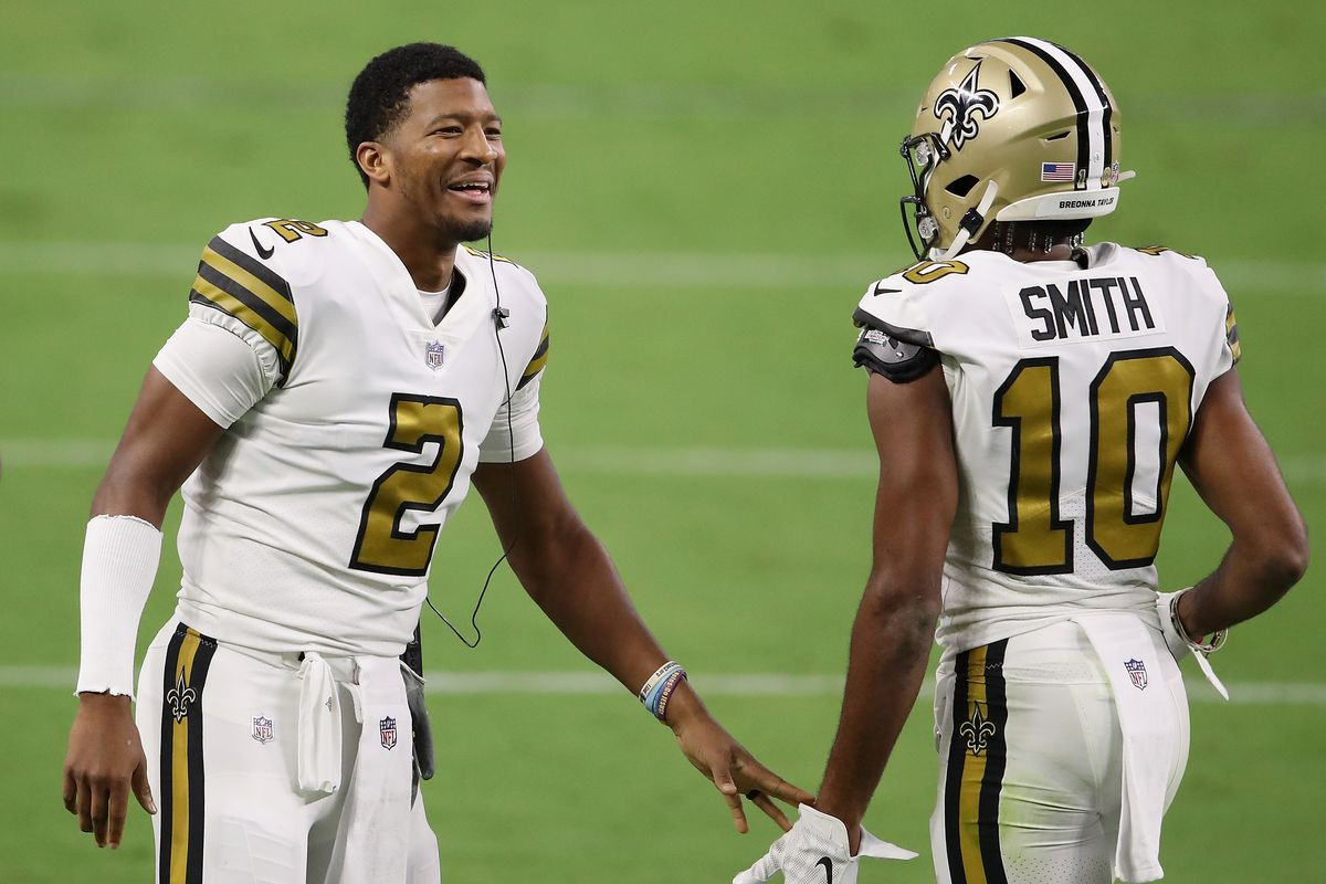Quarterback Jameis Winston #2 of the New Orleans Saints high fives wide receiver Tre'Quan Smith #10 during the NFL game against the Las Vegas Raiders at Allegiant Stadium on September 21, 2020 in Las Vegas, Nevada. The Raiders defeated the Saints 34-24.
