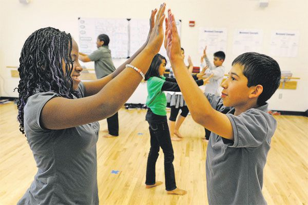 Kyra Collins, 12, Daniel Bojorquez, 11, and other 6th graders at Noel practice a salsa dance in 2012.