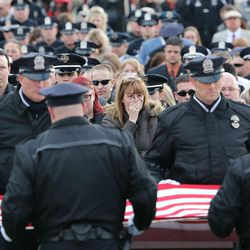The honor guard folds the flag on the casket of Unified police officer Doug Barney at the Orem City Cemetery on Monday, Jan. 25, 2016. Barney was killed in the line of duty on Jan. 17, 2016.