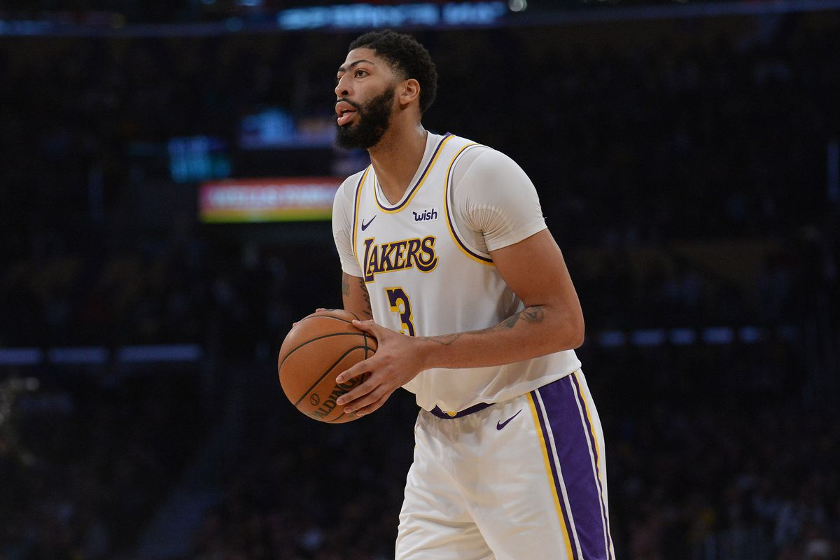 Los Angeles Lakers forward Anthony Davis controls the ball against the Dallas Mavericks during the second half at Staples Center.