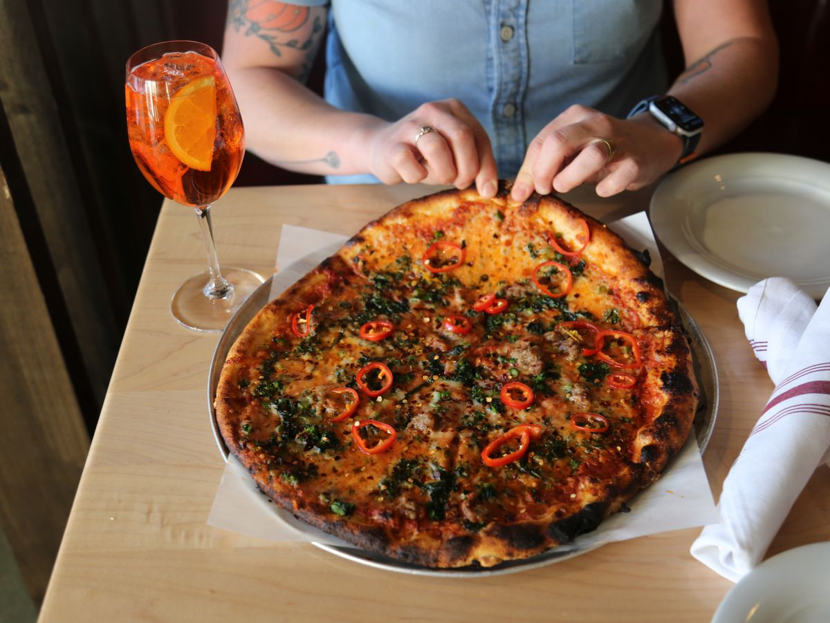 Sausage pizza with broccolini and red chiles