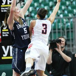 Brigham Young Cougars center Jennifer Hamson (5) defended Gonzaga Bulldogs guard Haiden Palmer (3) during the West Coast Conference championship game in Las Vegas Tuesday, March 11, 2014. BYU lost 71-57.