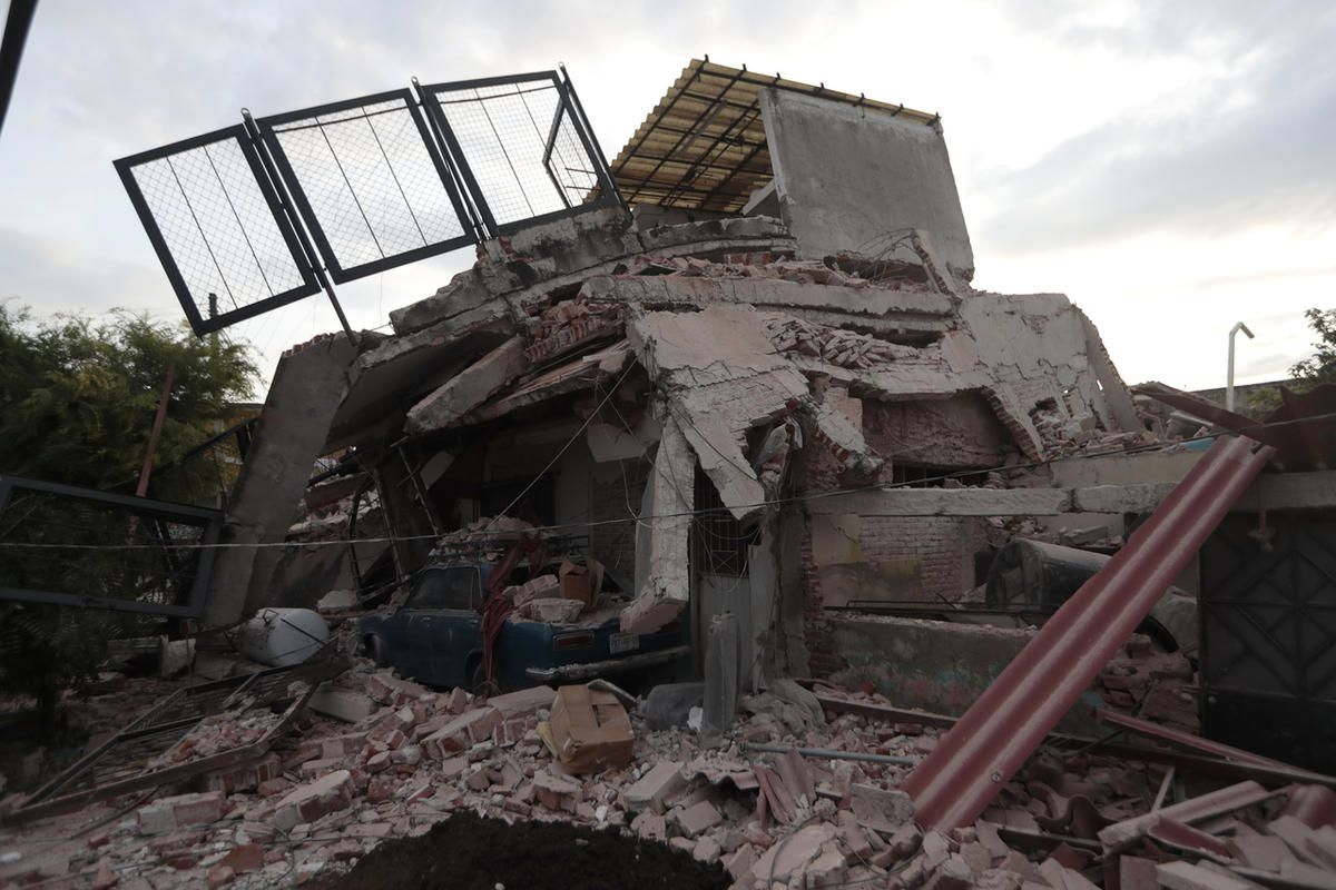A building demolished by a 7.1 earthquake sits in pile of rubble, in Jojutla, Morelos state, Mexico, Wednesday, Sept. 20, 2017. Police, firefighters and ordinary Mexicans are digging frantically through the rubble of collapsed schools, homes and apartment
