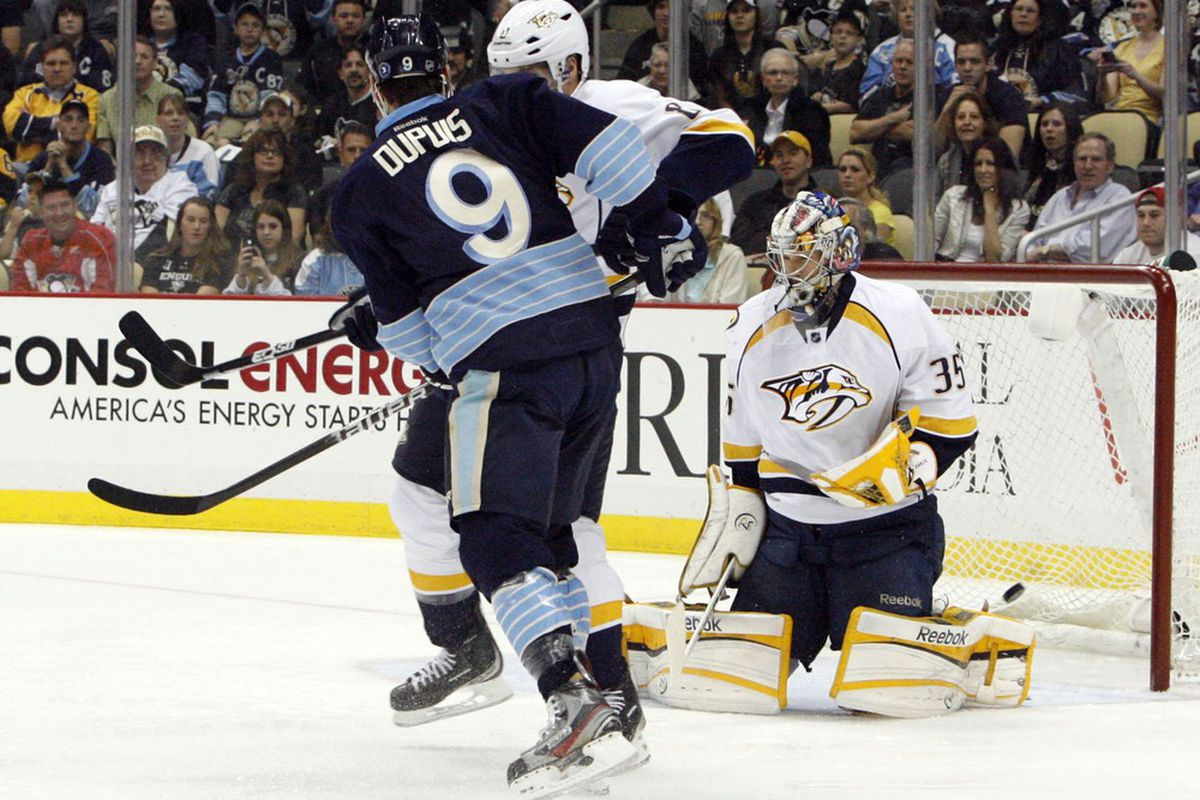 March 22, 2012; Pittsburgh, PA, USA; Pittsburgh Penguins right wing Pascal Dupuis (9) scores a goal past Nashville Predators goalie Pekka Rinne (35) during the first period at the CONSOL Energy Center. Mandatory Credit: Charles LeClaire-US PRESSWIRE