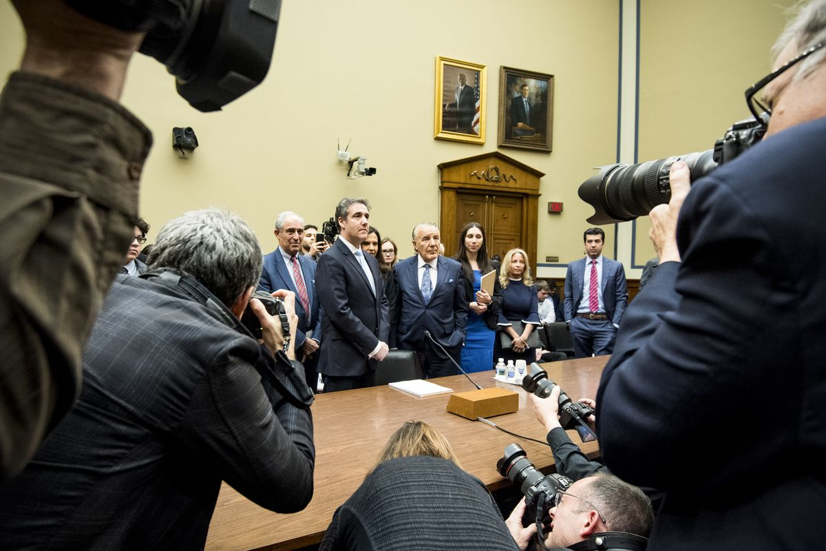 Former Trump attorney Michael Cohen has cameras aimed at him as he arrives to testify to the House Oversight Committee.