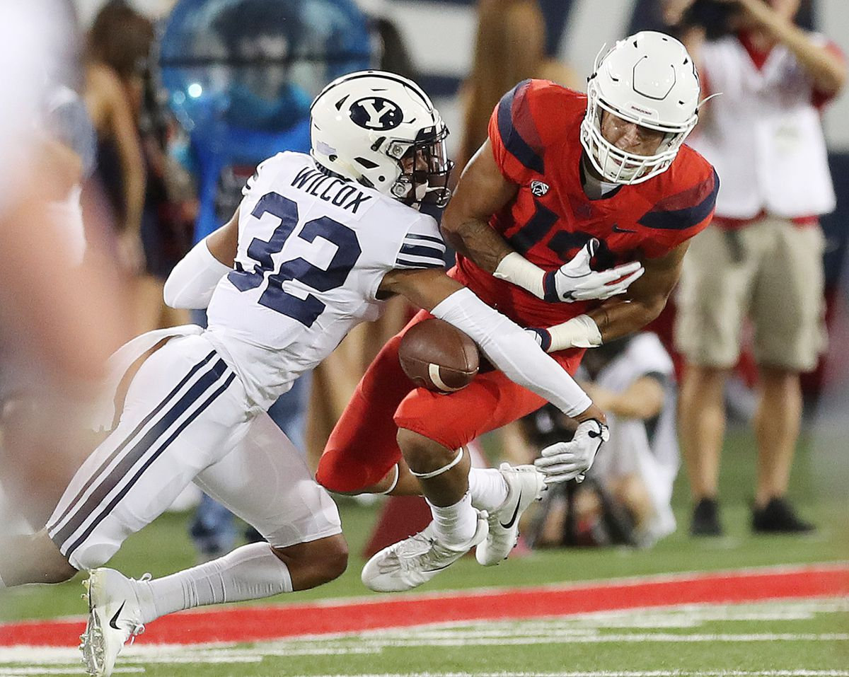 BYU defensive back Chris Wilcox defends Arizona wide receiver Shawn Poindexter in Tucson on Saturday, Sept. 1, 2018.