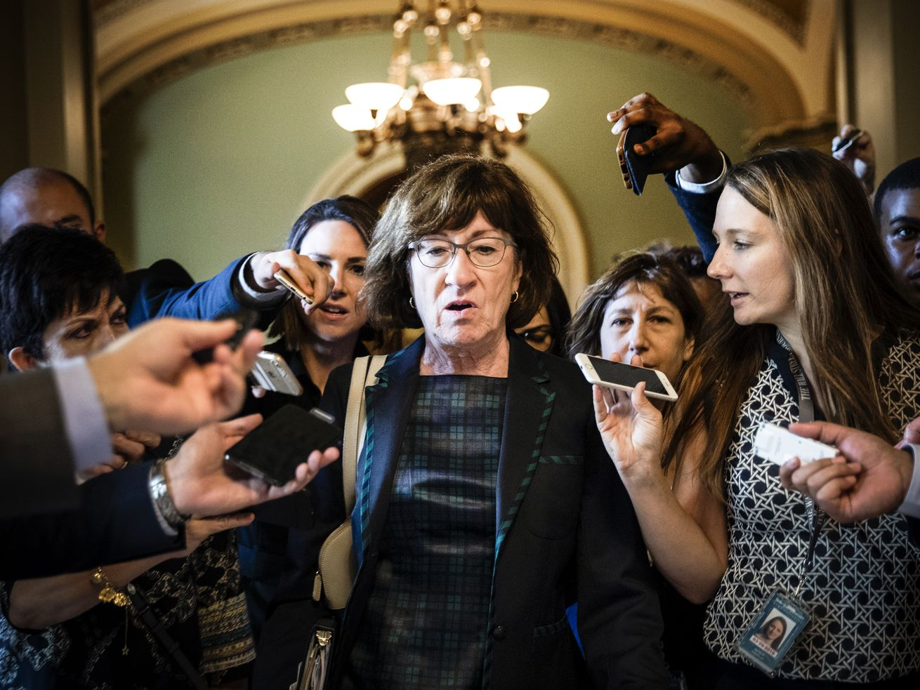 Sen. Susan Collins (R-ME) is surrounded by reporters following a closed-door meeting of Senate Republicans on September 26, 2018.