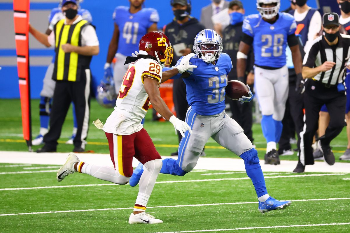 D'Andre Swift #32 of the Detroit Lions attempts to carry the ball against Kendall Fuller #29 of the Washington Football Team during their game at Ford Field on November 15, 2020 in Detroit, Michigan.