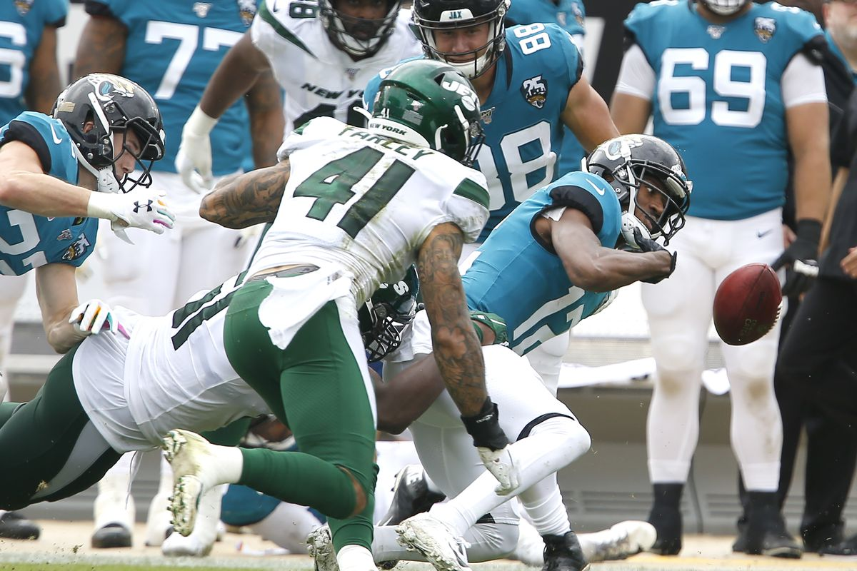 Jacksonville Jaguars wide receiver Dede Westbrook loses the ball on a kick return as New York Jets defensive back Matthias Farley closes in during the second quarter at TIAA Bank Field.