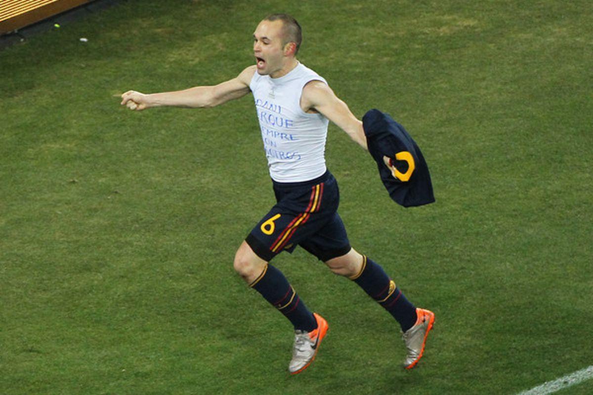 Iniesta celebrating the winning goal.  (Photo by Doug Pensinger/Getty Images)