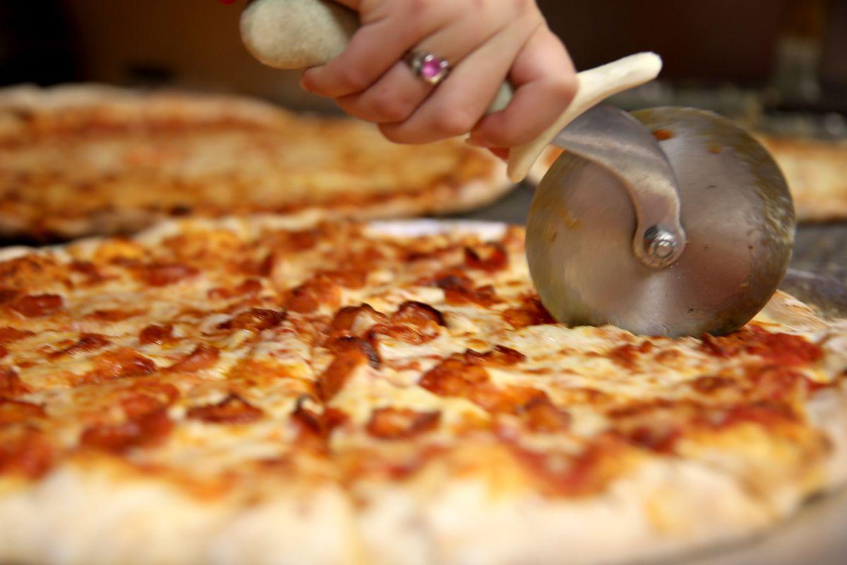 A pizza cutter in a pie