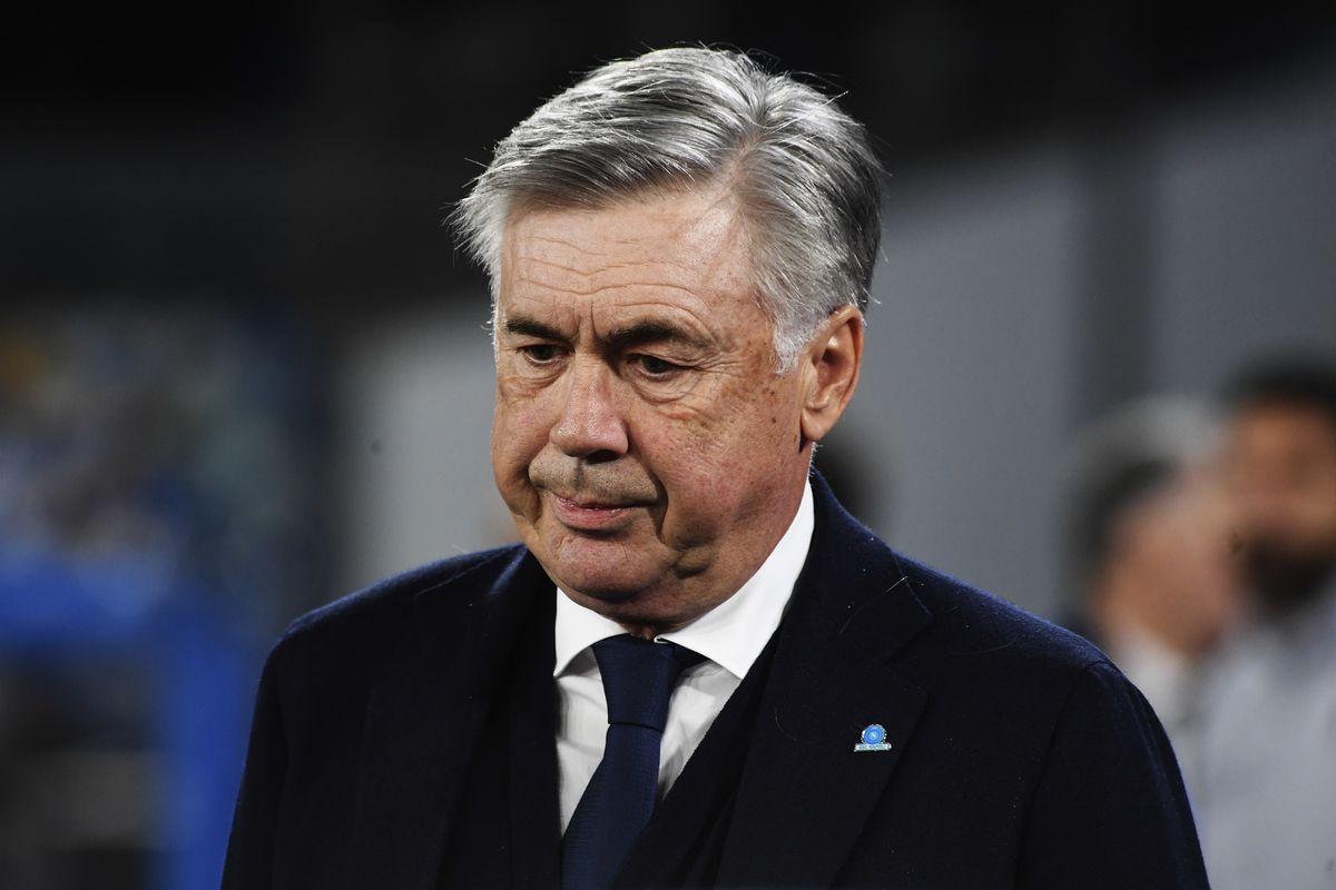 Napoli's Italian coach Carlo Ancelotti enters the pitch...