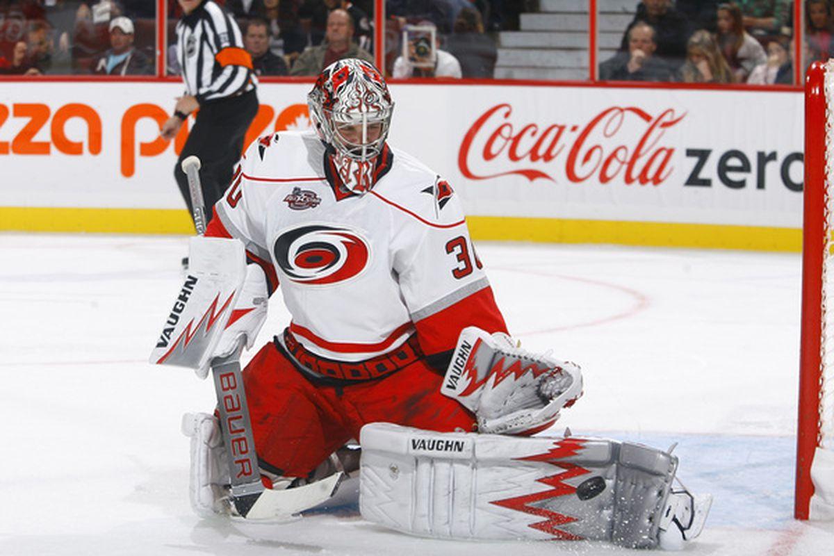 OTTAWA ON - OCTOBER 14:  Cam Ward #30 of the Carolina Hurricanes makes a pad save down low against the Ottawa Senators during a game at Scotiabank Place on October 14 2010 in Ottawa Ontario Canada.  (Photo by Phillip MacCallum/Getty Images)