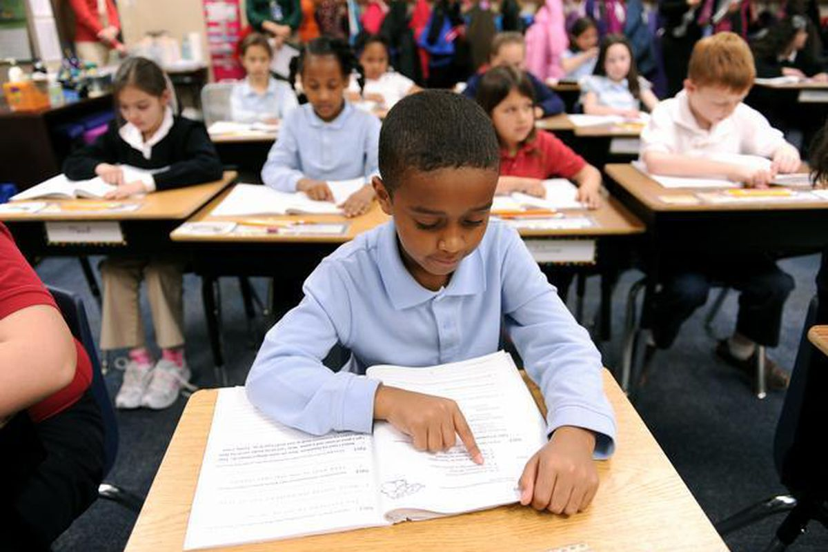 A student does classwork at James Irwin Charter Elementary School in Colorado Springs. (Denver Post file)