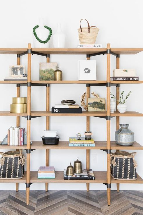 Wooden shelf with vases and books.