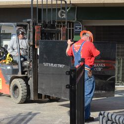 4:33 p.m. Moving the Ernie Banks pedestal into place -