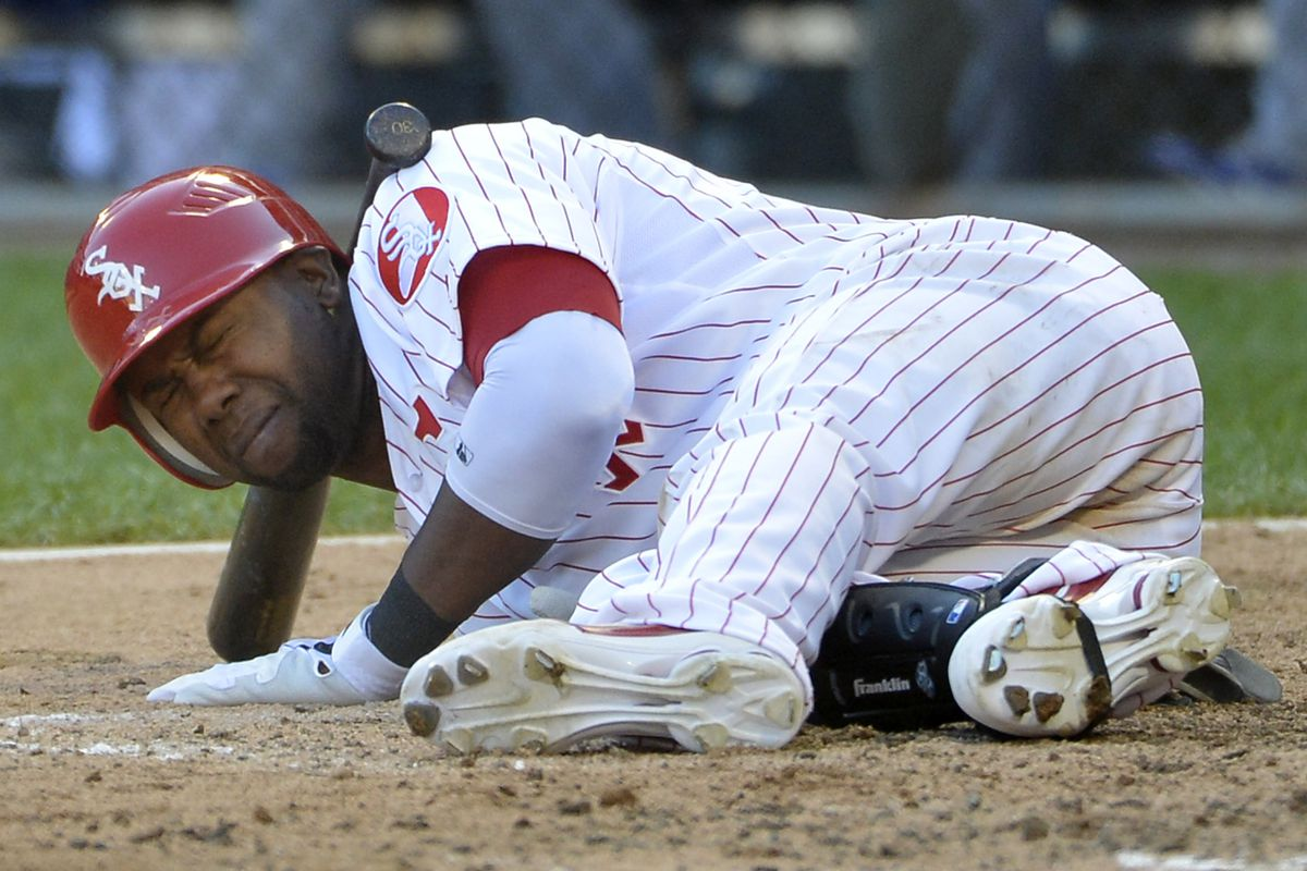 Alejandro De Aza ducks another bruise in the making on Sept. 9, 2012.