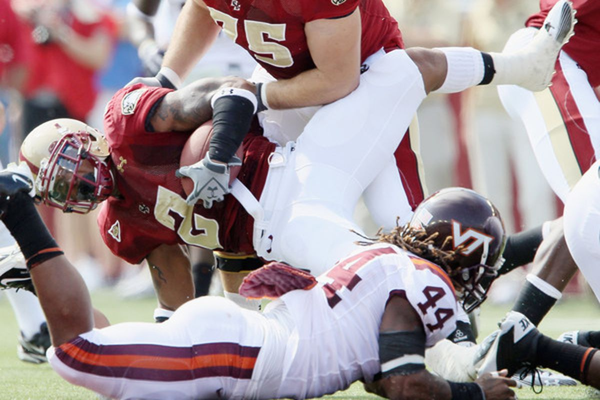 CHESTNUT HILL MA - SEPTEMBER 25:  Montel Harris #2 of the Boston College Eagles is stopped by Lyndell Gibson #44 of the Virginia Tech Hokies on September 25 2010 at Alumni Stadium in Chestnut Hill Massachusetts.  (Photo by Elsa/Getty Images)