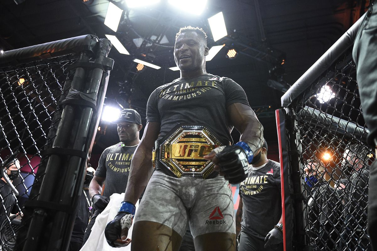 Francis Ngannou leaving the Octagon following his fight against Stipe Miocic at UFC 260.