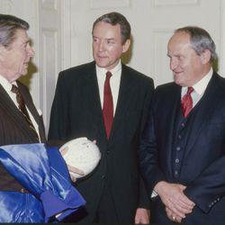 BYU head football coach LaVell Edwards talks with President Ronald Reagan and Sen. Orrin Hatch in 1994.
