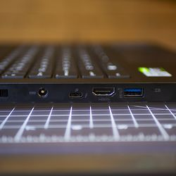 <em>The left side's ports include a barrel charging port, Thunderbolt 3, HDMI, and USB Type-A 3.12 Gen 2 port.</em>
