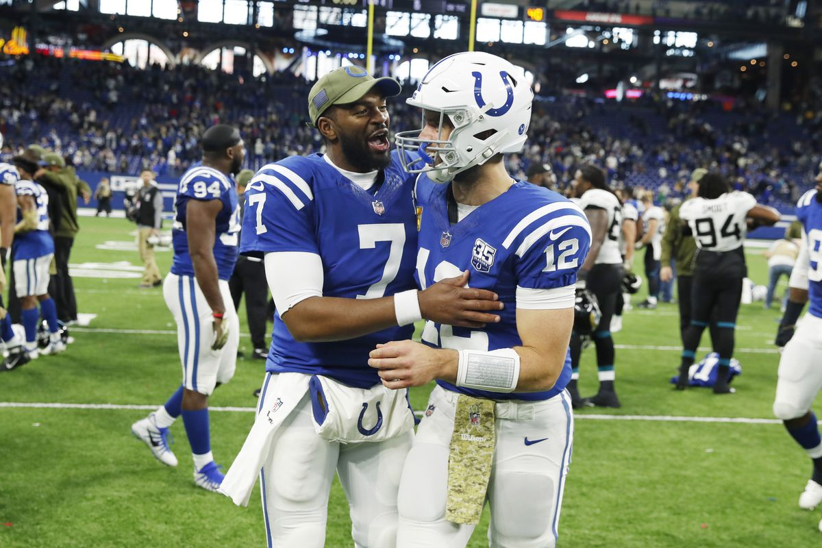 Indianapolis Colts quarterback Andrew Luck talks to quarterback Jacoby Brissett as he walks off the field after a game against the Jacksonville Jaguars at Lucas Oil Stadium.