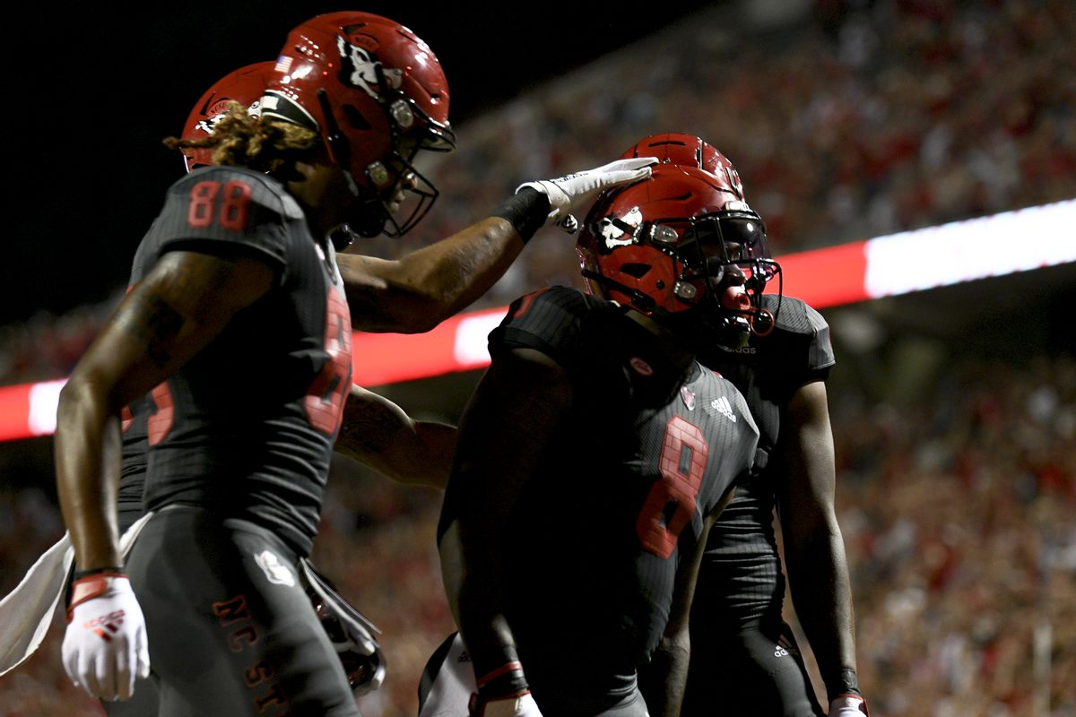 North Carolina State Wolfpack running back Ricky Person Jr. is congratulated after a touchdown run during the game between the South Florida Bulls and the NC State Wolfpack on September 2, 2021 at Carter-Finley Stadium in Raleigh, NC.
