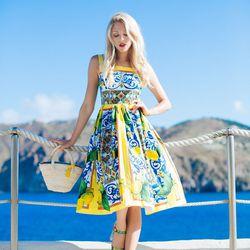 """Shea of <a href=""""http://peaceloveshea.com""""target=""""_blank"""">Peace Love Shea</a> is wearing a Dolce & Gabbana dress."""
