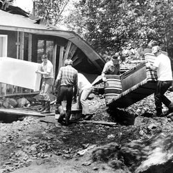 Residents reclaim possessions from home at corner of Fifth North and First East in Farmington, where home was deposited  by the massive onslaught of mud. June 4, 1983.