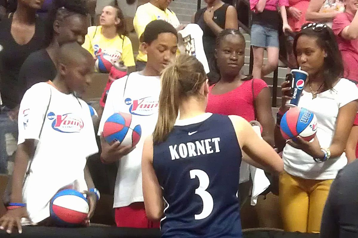 Nicole Kornet signs autographs for the crowd after winning Blue Team MVP on Saturday.