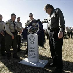 Salt Lake County sheriff's officers take part in the dedication of a headstone for deputy James D. Hulsey, who was killed in the line of duty in 1913. The ceremony was held Monday at the Bingham City Cemetery.