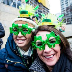 Yvonne Coviello and Lisa Chirico come out to see the Plumber's Local Union 130 dye the Chicago River green in celebration of St. Patrick's Day, Saturday, March 17th, 2018. | James Foster/For the Sun-Times