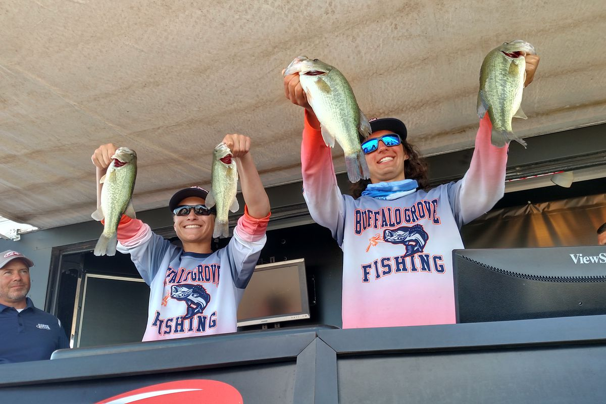 This will be the first year with no state championship for high school bass fishing since the IHSA recognized the activity in 2008-09; shown here are Dominic Domian (lleft) and All-American Tyler Lubbat lifting their clinching four keepers, which led Buffalo Grove in 2017 to the Chicago area's only state championship. Credit: Dale Bowman