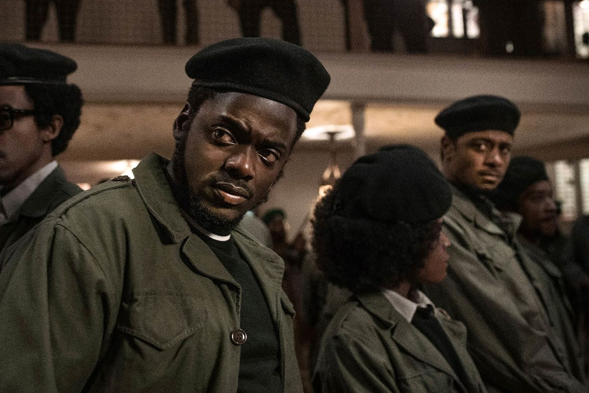 In an image from the film Judas and the Black Messiah, young Black Panthers stand wearing green jackets and black berets.
