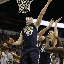 Utah Jazz's Brock Motum goes up for a shot against the Milwaukee Bucks during the first half of an NBA summer league basketball game Monday, July 14, 2014, in Las Vegas. (AP Photo/John Locher)