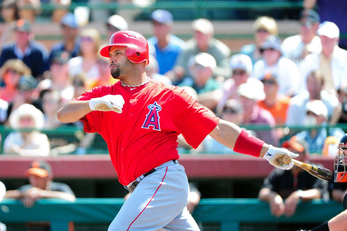 Mar. 27, 2012; Scottsdale, AZ, USA; Los Angeles Angels first baseman Albert Pujols (5) grounds out during the first inning against the San Francisco Giants at Scottsdale Stadium.  Mandatory Credit: Matt Kartozian-US PRESSWIRE