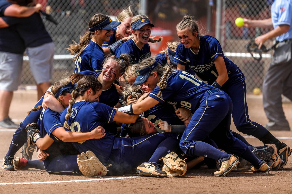 Enterprise Wolves players celebrate after winning the 2A softball championship, beating Beaver 5-2 on May 15, 2021.