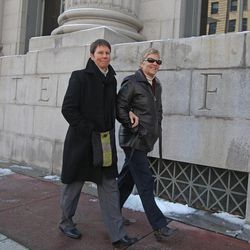 Kody Partridge, left, and her partner Laurie Wood leave the Frank E. Moss United States Courthouse Wednesday, Dec. 4, 2013, in Salt Lake City. A challenge to Utah's same-sex marriage ban by three gay couples is back in court Wednesday as a federal court judge heard arguments in a case being closely watched around the country. Partridge and Wood are plaintiff's in this case.