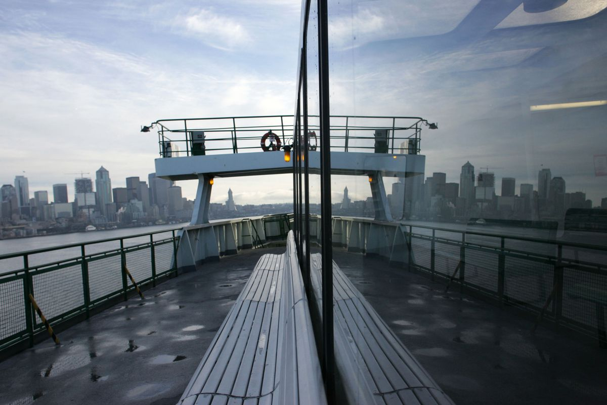 SEATTLE - DECEMBER 14: The Seattle skyline is reflected in the window of a Washington State Ferry as it departs Seattle Pier 52 for Bainbridge Island, Washington December 14, 2005 in Seattle, Washington. Teams of undercover air marshals and uniformed law