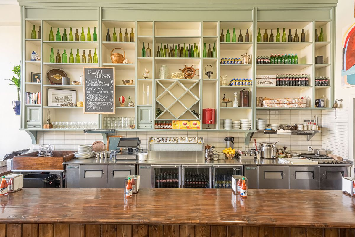 View behind the bar at Found Oyster, East Hollywood, with counters and knicknacks on the wall.