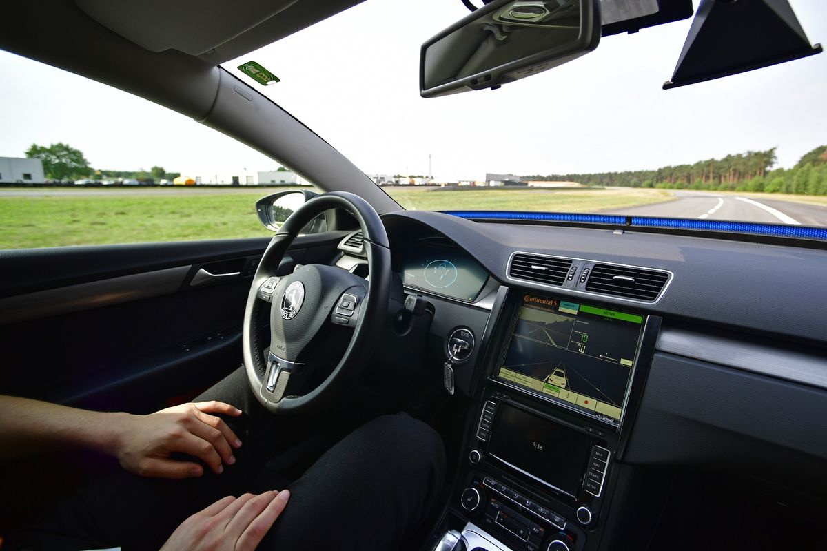 A driver presents a Cruising Chauffeur, a hands-free self-driving system designed for motorways.
