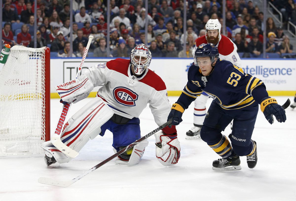 Nov 23, 2018; Buffalo, NY, USA; Montreal Canadiens goaltender Antti Niemi (37) watches as Buffalo Sabres left wing Jeff Skinner (53) goes after a loose puck in overtime at KeyBank Center. Mandatory Credit: Timothy T. Ludwig