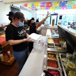 Cashier Marianna Skalla and Miriam Fernandez prepare orders at Santo Taco in Salt Lake City on Wednesday, Dec. 9, 2020. According to census data, Utahns as a whole are bringing in more money, but those of minority racial and ethnic backgrounds aren't taking home equal pieces of the pie.