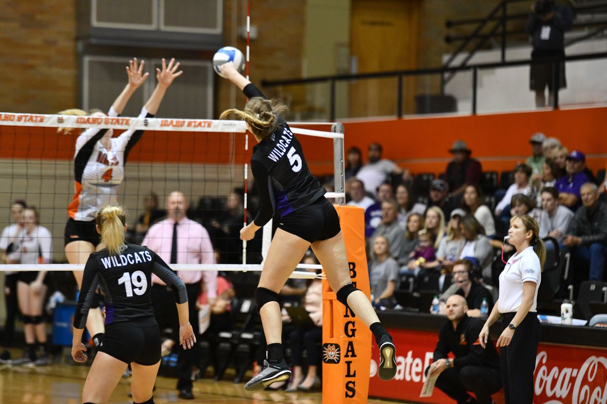 Andrea Hale (center) goes for a kill against Idaho State. Hale had 20 kills against ISU in Weber State's four-set victory.