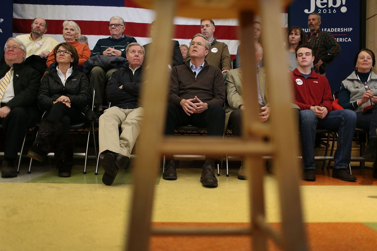 Lindsey Graham and Jeb Bush sit around at a town hall in New Hampshire.