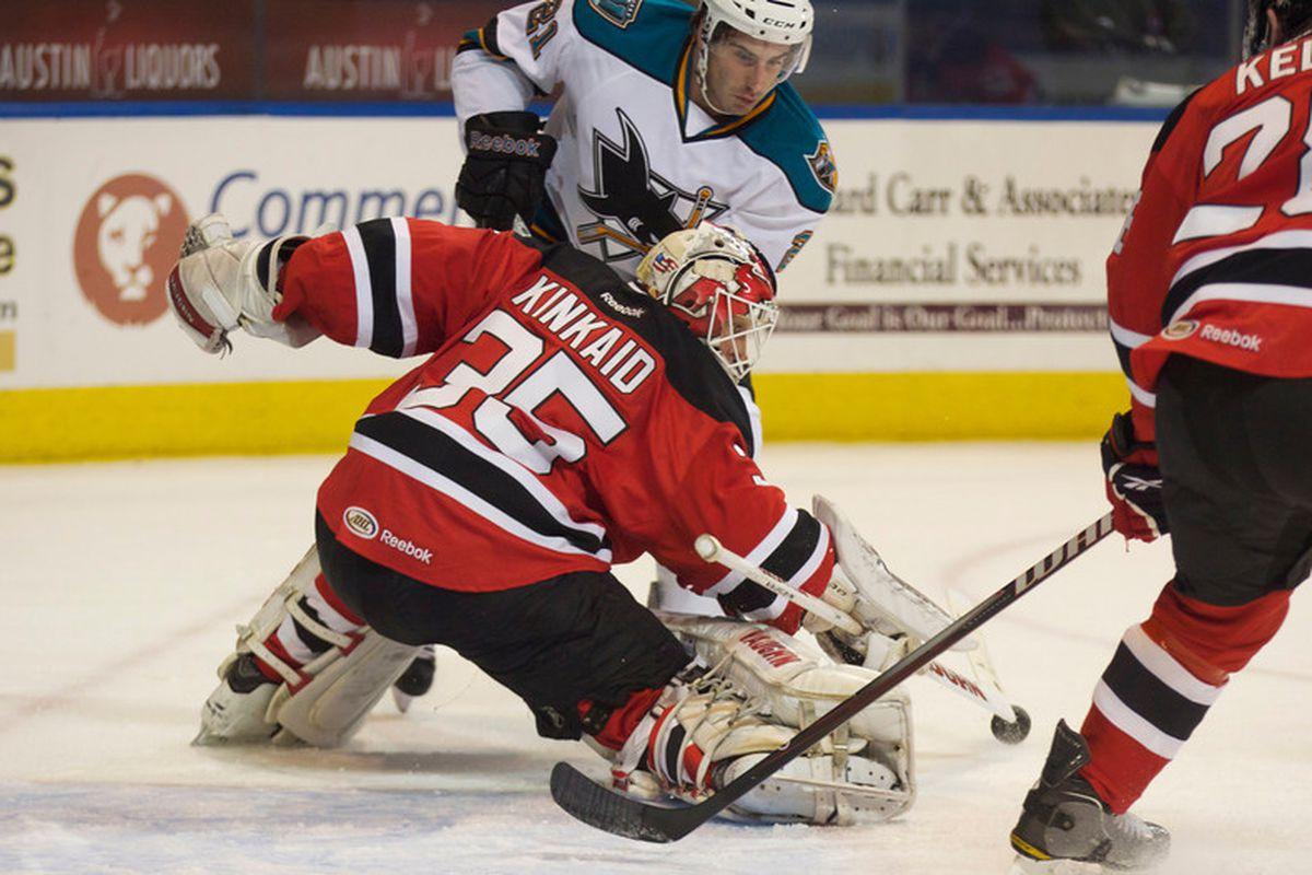 Worcester Sharks rookie Travis Oleksuk is denied by Albany Devils goalie Keith Kinkaid.