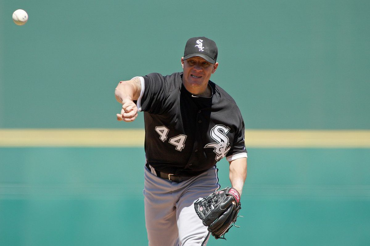 Apr 1, 2012; Goodyear, AZ, USA; Chicago White Sox starting pitcher Jake Peavy (44) pitches against the Cincinnati Reds during the second inning at Goodyear Ballpark.  Mandatory Credit: Jake Roth-US PRESSWIRE