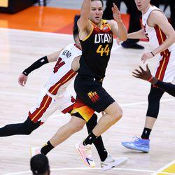 Utah Jazz forward Bojan Bogdanovic (44) passes to teammate Utah Jazz forward Royce O'Neale (23) as the Utah Jazz and the Miami Heat play an NBA basketball game at Vivint Smart Home Arena in Salt Lake City on Saturday, Feb. 13, 2021. Utah won 112-94.