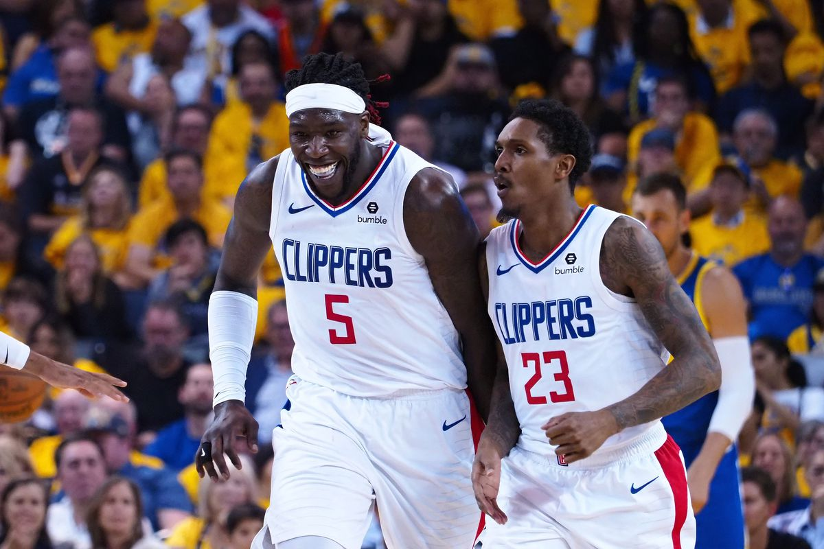 LA Clippers forward Montrezl Harrell celebrates with guard Lou Williams after a play against the Golden State Warriors during the fourth quarter in game five of the first round of the 2019 NBA Playoffs at Oracle Arena.